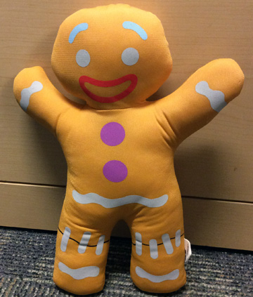 "Stuffed toy of ""Gingy"" the gingerbread man from Shrek."