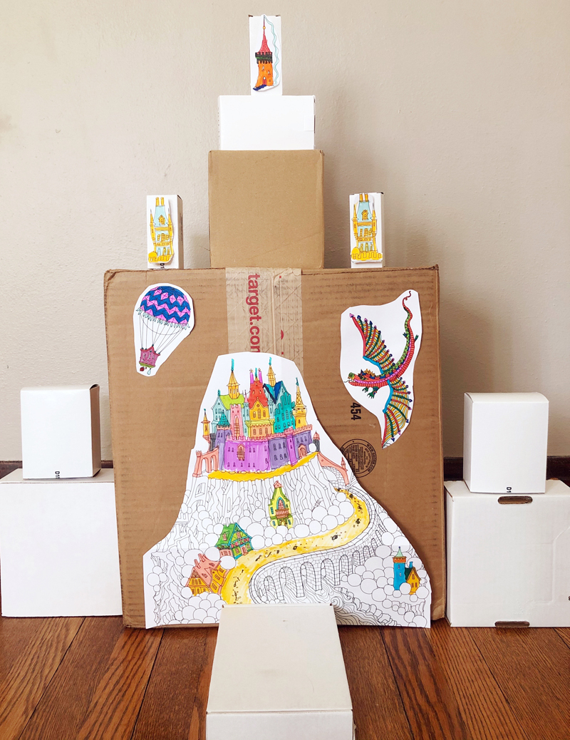 Castle made from cardboard boxes and  hand-colored castle images