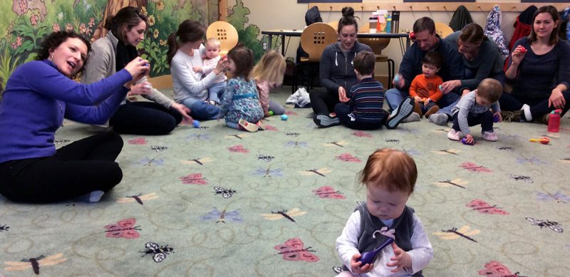 Music Together teacher Catherine Olson sings with children and their grown-ups.