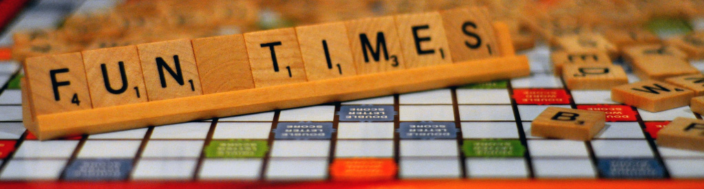 "Scrabble board with tiles spelling ""FUN TIMES"""