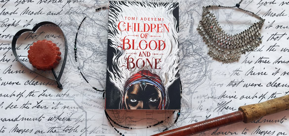Children of Blood and Bone book with jewely, heart, old script