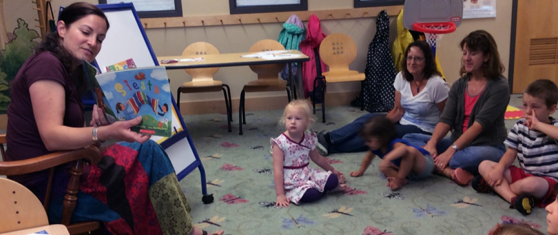 """Teacher Krista Thusius reads """"Siesta"""" to a group of children, parents and grandparents"""