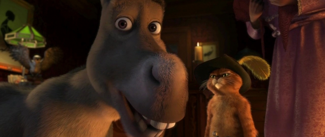 Scene capture from Scared Shrekless with Donkey in the foreground and Puss in Boots behind him.